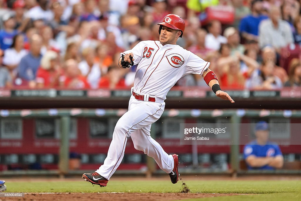 Skip Schumaker of the Cincinnati Reds runs the bases against the Chicago Cubs at Great American Ball Park on July 9 2014 in Cincinnati Ohio