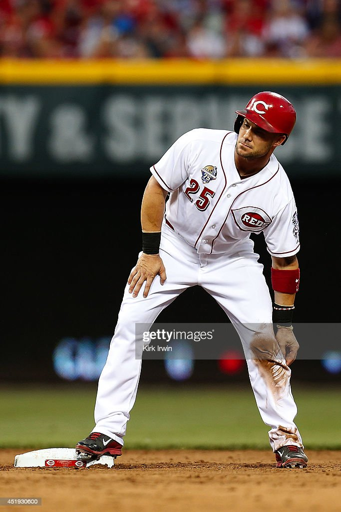 Skip Schumaker of the Cincinnati Reds safely makes it to second base during the game against the Milwaukee Brewers at Great American Ball Park on...
