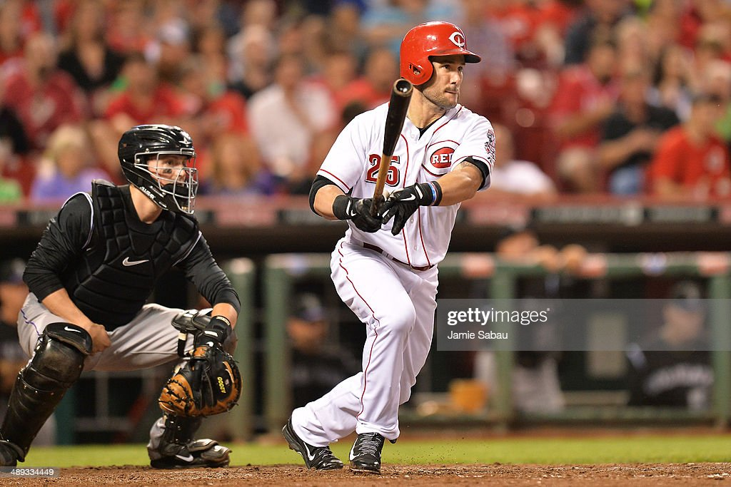 Skip Schumaker of the Cincinnati Reds singles in the fifth inning against the Colorado Rockies at Great American Ball Park on May 10 2014 in...