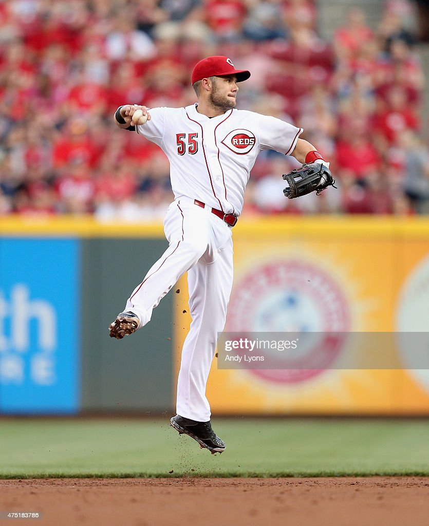Skip Schumaker of the Cincinnati Reds throws throws the ball to firstbase during the game against the Washington Nationals at Great American Ball...