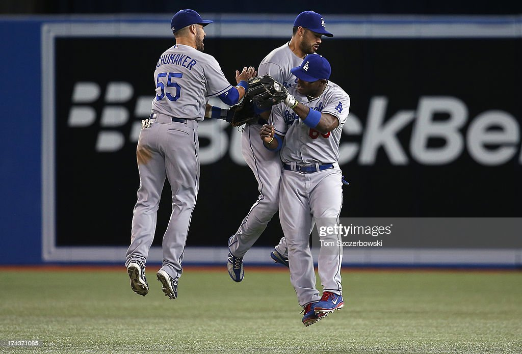 <a gi-track='captionPersonalityLinkClicked' href=/galleries/search?phrase=Skip+Schumaker&family=editorial&specificpeople=640599 ng-click='$event.stopPropagation()'>Skip Schumaker</a> #55 of the Los Angeles Dodgers celebrates their victory with <a gi-track='captionPersonalityLinkClicked' href=/galleries/search?phrase=Andre+Ethier&family=editorial&specificpeople=543213 ng-click='$event.stopPropagation()'>Andre Ethier</a> #16 and <a gi-track='captionPersonalityLinkClicked' href=/galleries/search?phrase=Yasiel+Puig&family=editorial&specificpeople=10484087 ng-click='$event.stopPropagation()'>Yasiel Puig</a> #66 during MLB game action against the Toronto Blue Jays on July 24, 2013 at Rogers Centre in Toronto, Ontario, Canada.