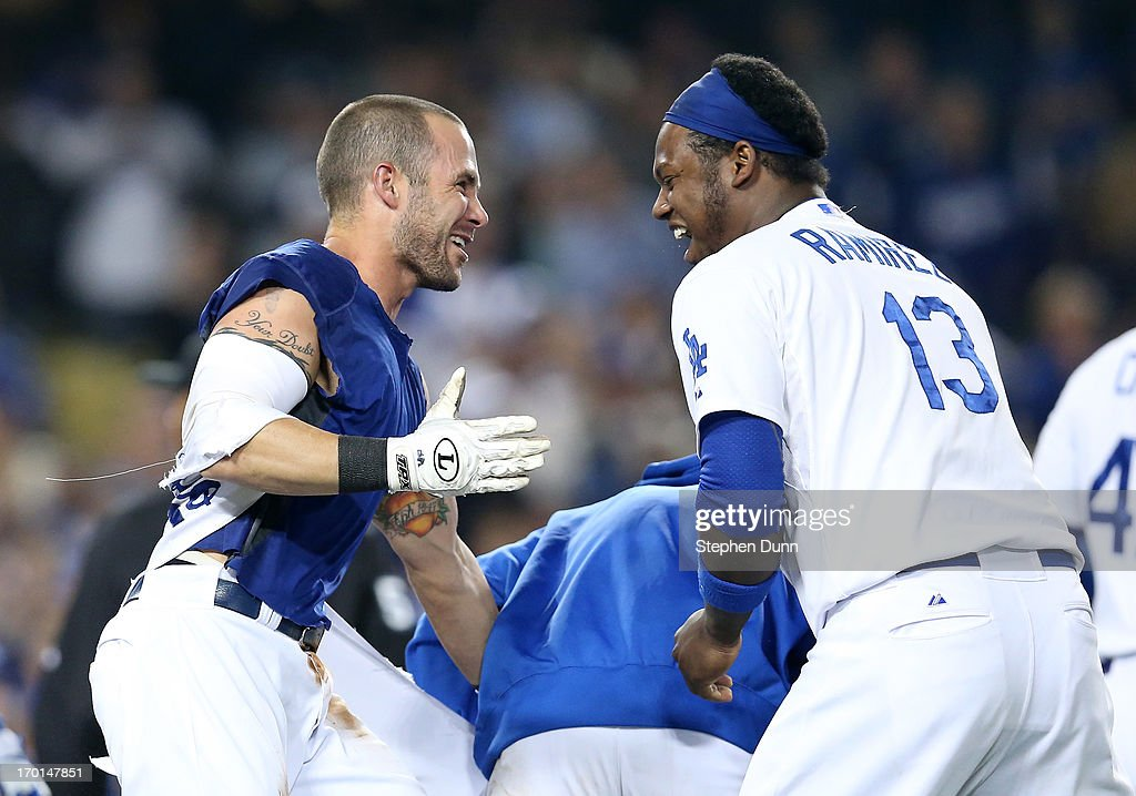 <a gi-track='captionPersonalityLinkClicked' href=/galleries/search?phrase=Skip+Schumaker&family=editorial&specificpeople=640599 ng-click='$event.stopPropagation()'>Skip Schumaker</a> #3 (L) of the Los Angeles Dodgers celebrates with <a gi-track='captionPersonalityLinkClicked' href=/galleries/search?phrase=Hanley+Ramirez&family=editorial&specificpeople=538406 ng-click='$event.stopPropagation()'>Hanley Ramirez</a> #13 after scoring the winning run on a wild pitch in the 10th inning against the Atlanta Braves at Dodger Stadium on June 7, 2013 in Los Angeles, California. The Dodgers won 2-1 in 10 innings.