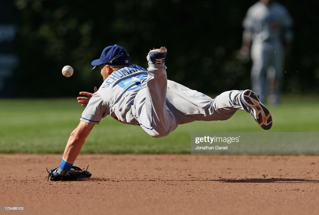 Skip Schumaker of the Los Angeles Dodgers flips the ball after making a diving catch to begin a double play in the 5th inning against the Chicago...