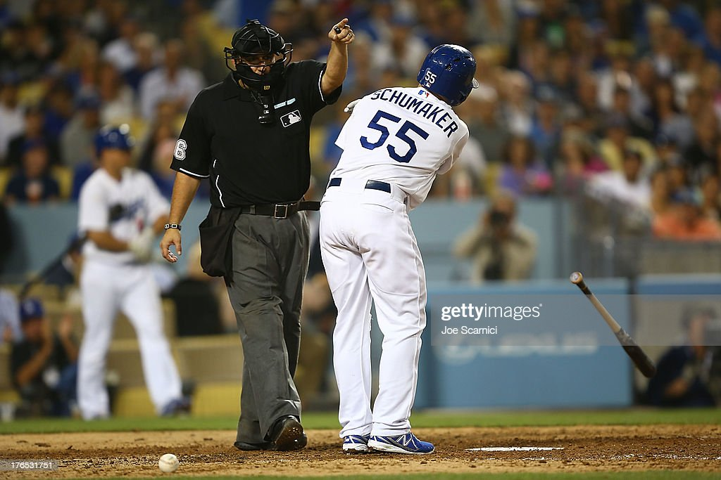 <a gi-track='captionPersonalityLinkClicked' href=/galleries/search?phrase=Skip+Schumaker&family=editorial&specificpeople=640599 ng-click='$event.stopPropagation()'>Skip Schumaker</a> #55 of the Los Angeles Dodgers gets a walk to first after getting hit by a ball in the ankle in the sixth inning against the New York Mets at Dodger Stadium on August 14, 2013 in Los Angeles, California.
