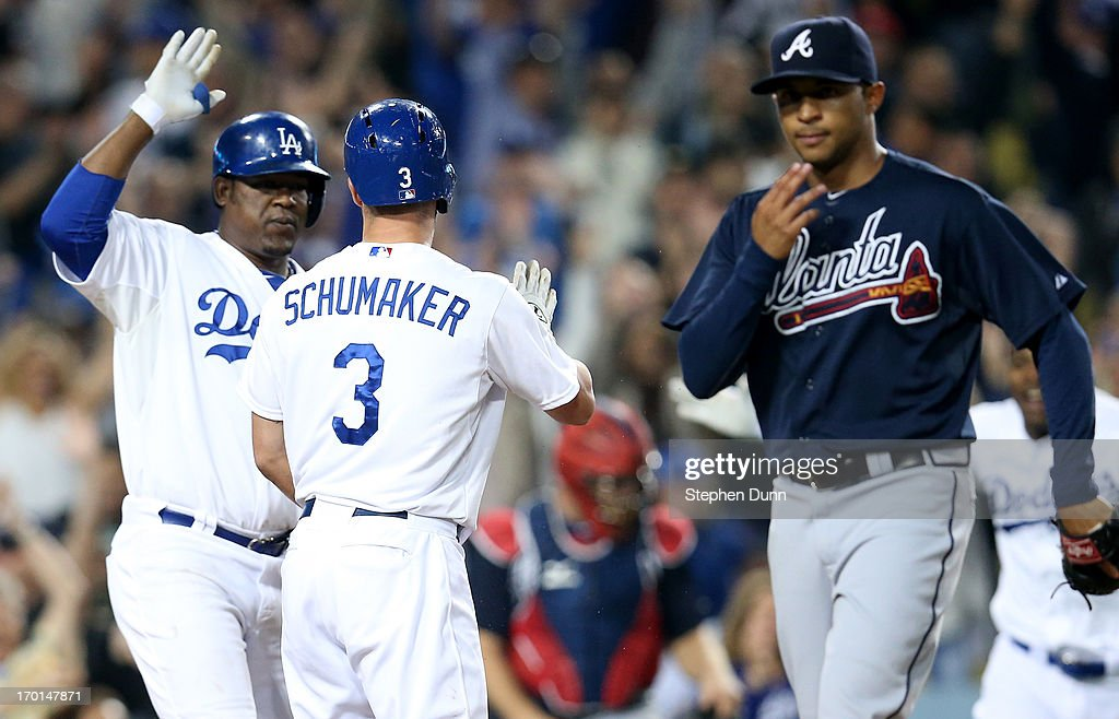 <a gi-track='captionPersonalityLinkClicked' href=/galleries/search?phrase=Skip+Schumaker&family=editorial&specificpeople=640599 ng-click='$event.stopPropagation()'>Skip Schumaker</a> #3 of the Los Angeles Dodgers is greeted by Juan Uribe #5 after scoring the winning run in the 10th inning on a wild pitch by reliever <a gi-track='captionPersonalityLinkClicked' href=/galleries/search?phrase=Anthony+Varvaro&family=editorial&specificpeople=6778043 ng-click='$event.stopPropagation()'>Anthony Varvaro</a> #38 (R) of the Atlanta Braves at Dodger Stadium on June 7, 2013 in Los Angeles, California. The Dodgers won 2-1 in 10 innings.