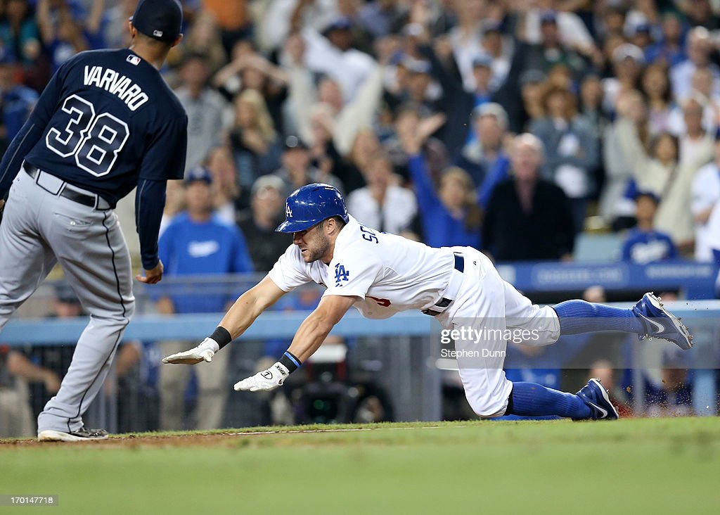 <a gi-track='captionPersonalityLinkClicked' href=/galleries/search?phrase=Skip+Schumaker&family=editorial&specificpeople=640599 ng-click='$event.stopPropagation()'>Skip Schumaker</a> #3 of the Los Angeles Dodgers scores the winning run in the 10th inning on a wild pitch by reliever <a gi-track='captionPersonalityLinkClicked' href=/galleries/search?phrase=Anthony+Varvaro&family=editorial&specificpeople=6778043 ng-click='$event.stopPropagation()'>Anthony Varvaro</a> #38 of the Atlanta Braves at Dodger Stadium on June 7, 2013 in Los Angeles, California. The Dodgers won 2-1 in 10 innings.