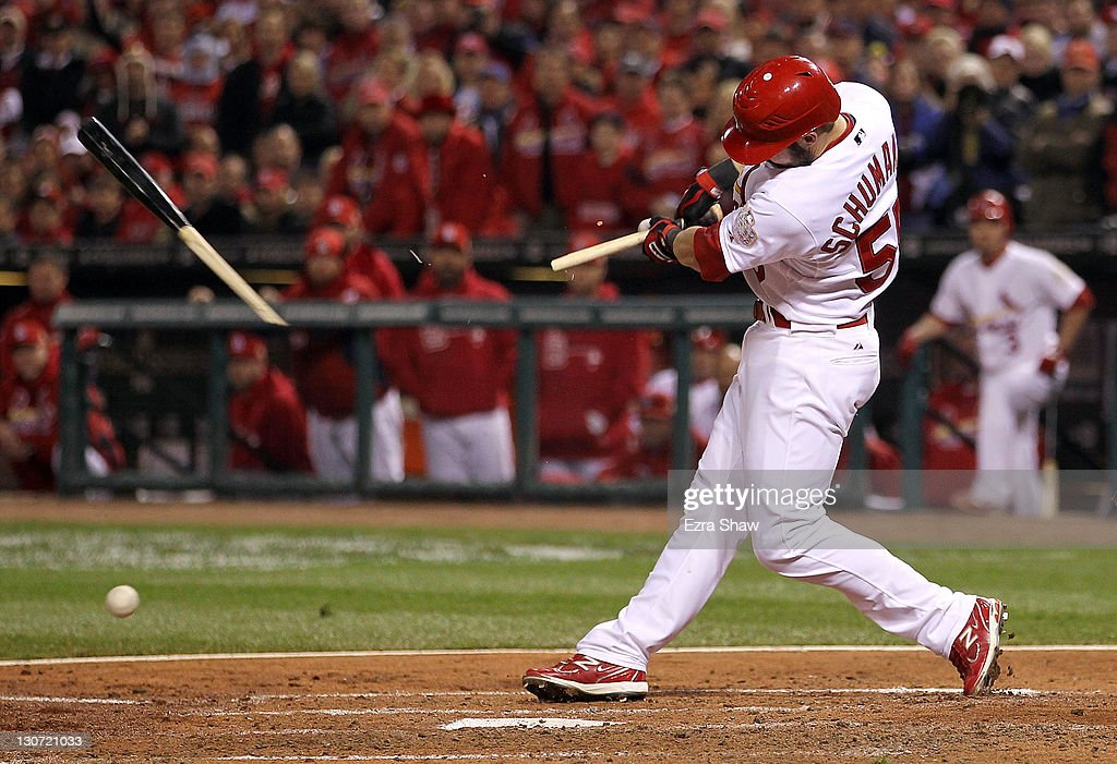 Skip Schumaker of the St Louis Cardinals breaks his bat on a ground out in the fourth inning during Game Seven of the MLB World Series against the...