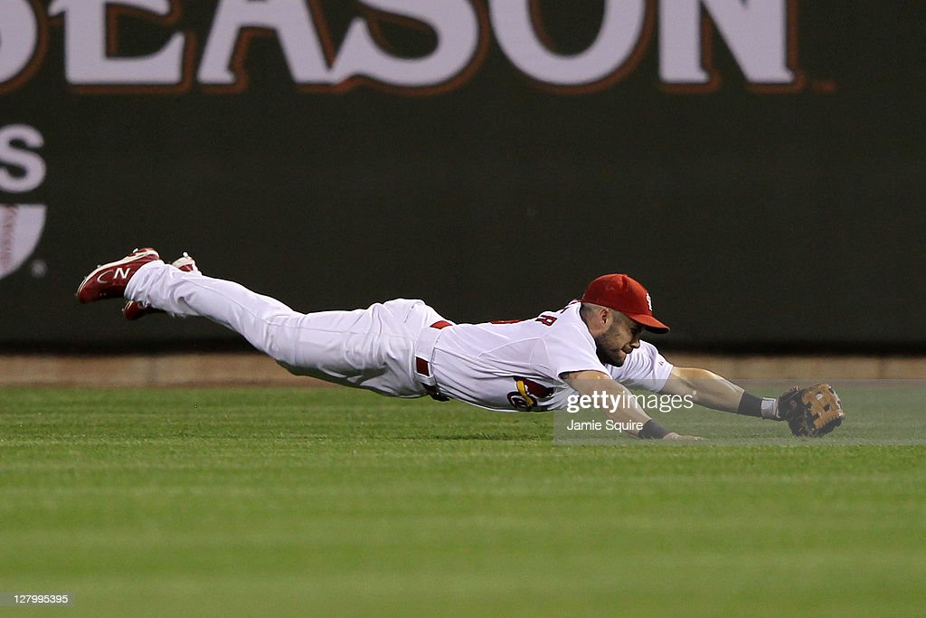 Skip Schumaker of the St Louis Cardinals makes a diving catch in the on a fly ball by Carlos Ruiz of the Philadelphia Phillies in the ninth inning of...