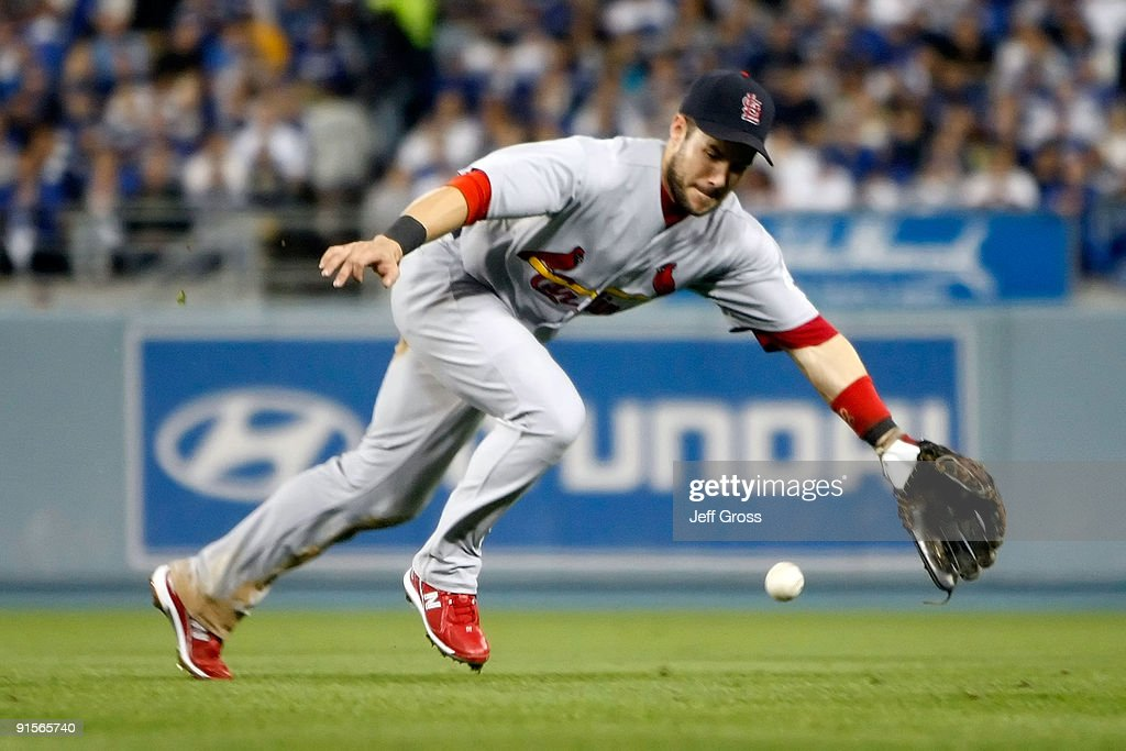 Skip Schumaker of the St Louis Cardinals makes a play at second base but is late on a throw allowing a base hit by Andre Ethier of the Los Angeles...