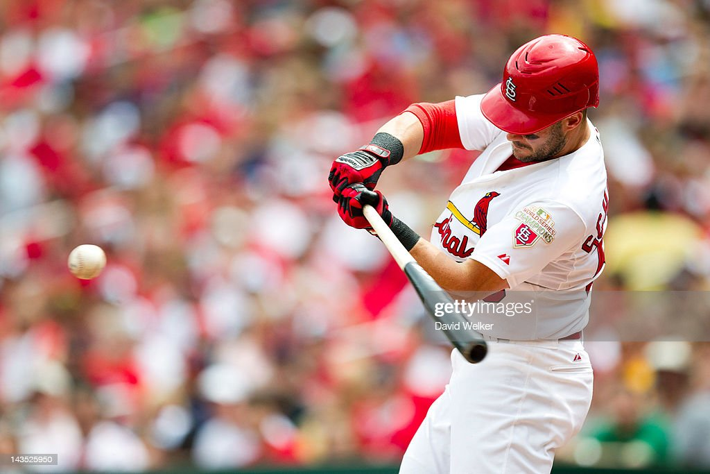 Skip Schumaker of the St Louis Cardinals makes contact on a pitch during a game against the Milwaukee Brewers at Busch Stadium on April 28 2012 in St...