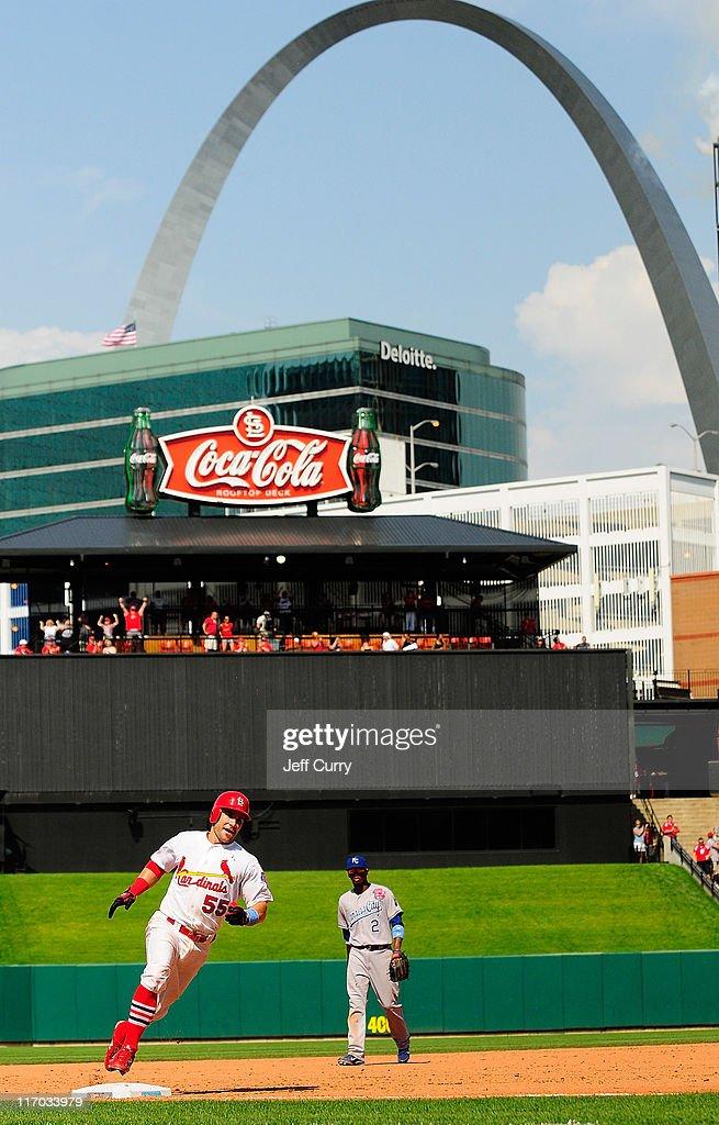 Skip Schumaker of the St Louis Cardinals rounds third base after hitting a walk off home run against the Kansas City Royals at Busch Stadium on June...
