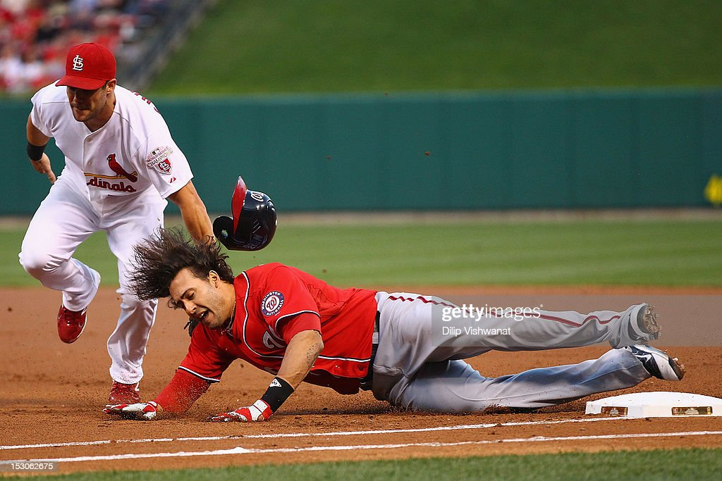 Skip Schumaker of the St Louis Cardinals tags out Michael Morse of the Washington Nationals before Morse's hit was ruled a home run after a review by...