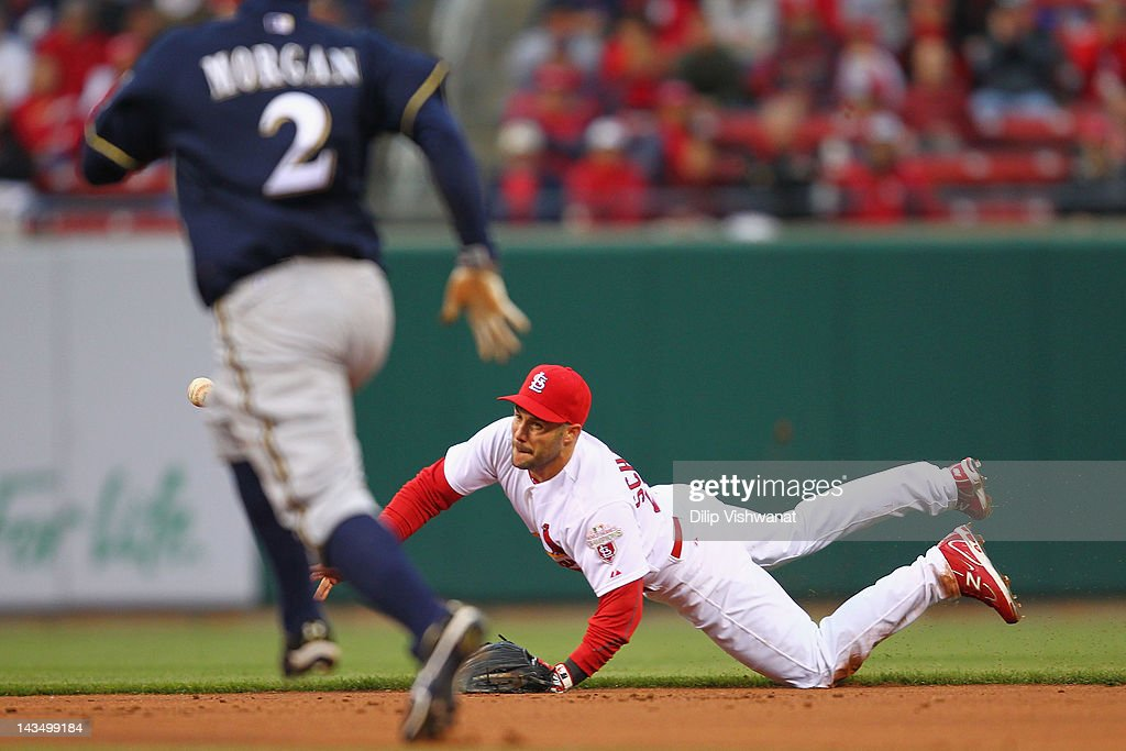 Skip Schumaker of the St Louis Cardinals tosses the ball to second base against the Milwaukee Brewers at Busch Stadium on April 27 2012 in St Louis...