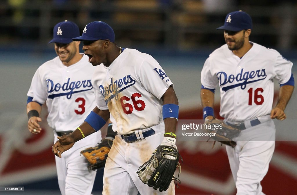 Skip Schumaker Yasiel Puig and Andre Ethier of the Los Angeles Dodgers react after defeating the San Francisco Giants 31 in their MLB game at Dodger...