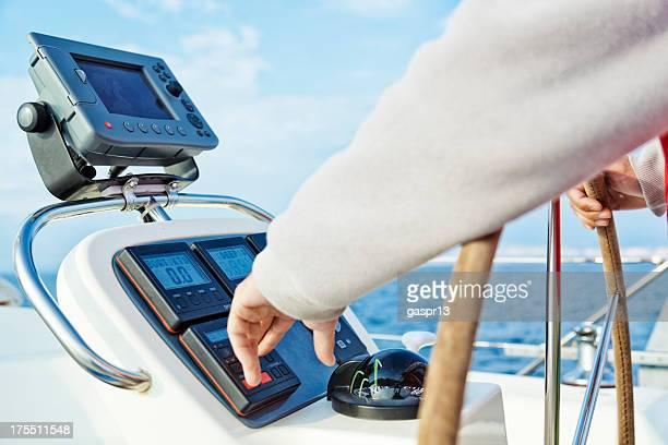 skipper adjusting yacht's auto pilot