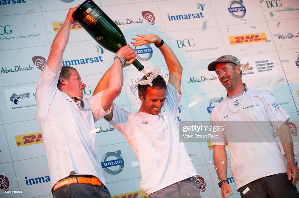 Skipper Franck Cammas from France and Martin Krite from Sweden spray a magnum of champagne as Groupama Sailing Team celebrate winning the DHL In-Port Race in the Volvo Ocean Race 2011-12 on April 21, 2012 in Itajai, Brazil.
