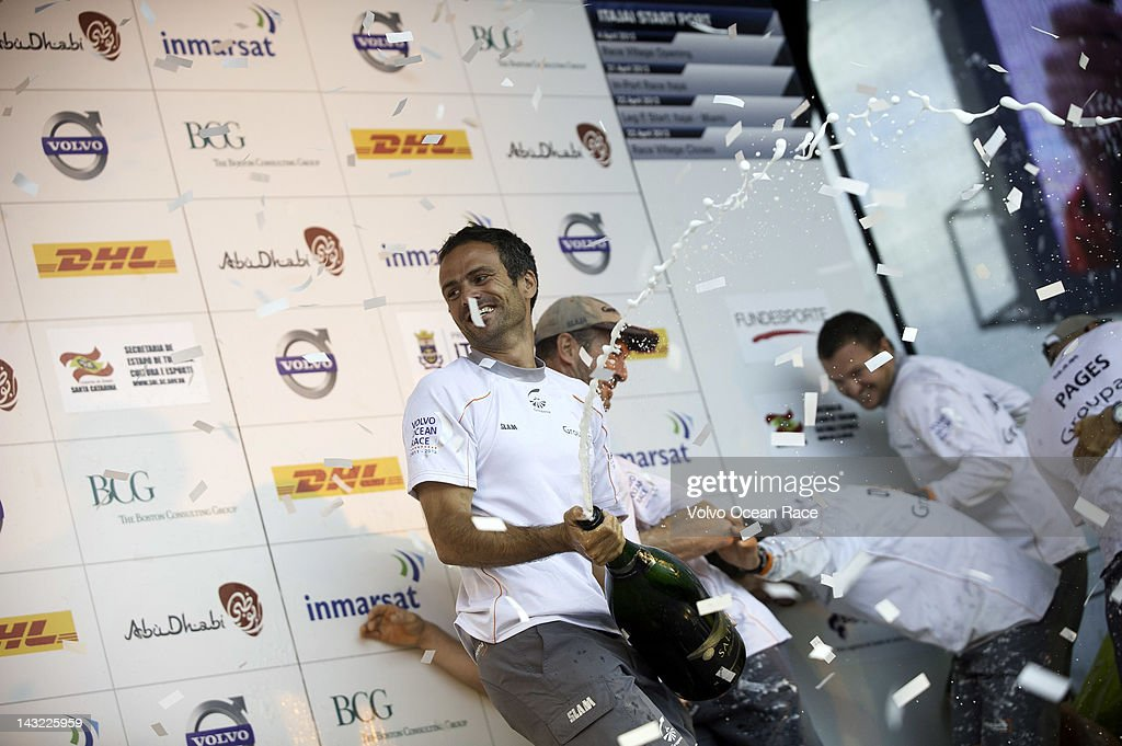 Skipper Franck Cammas from France sprays a magnum of champagne as Groupama Sailing Team celebrate winning the DHL In-Port Race in the Volvo Ocean Race 2011-12 on April 21, 2012 in Itajai, Brazil.