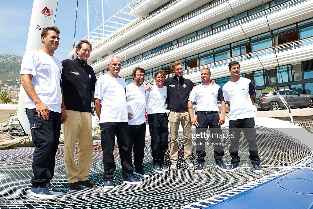 Skipper Giovanni Soldini (4th from L) and chairman of Fiat Chrysler Automobiles NV <a gi-track='captionPersonalityLinkClicked' href=/galleries/search?phrase=John+Elkann&family=editorial&specificpeople=571803 ng-click='$event.stopPropagation()'>John Elkann</a> (2nd from L) pose with the Maserati Multi70 crew during a press conference at YCM on June 29, 2016 in Monte-Carlo, Monaco.