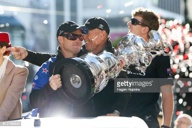 Skipper Glenn Ashby holds the Americas Cup while CEO Grant Dalton and Helmsman Peter Burling look on during the Team New Zealand Americas Cup...