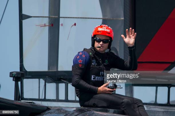 Skipper Glenn Ashby of Emirates Team New Zealand skippered by Peter Burling waves after winning both races on day one of the America's Cup Finals on...