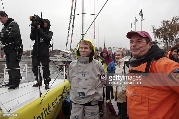 Skipper of the Imoca 60 Macif French Francois Gabart and skipper of the Imoca 60 Safran Marc Guillemot wait for the start on November 7 2013 in Le...