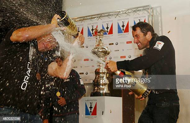 Skipper Sir Ben Ainslie of Britain's Land Roverbacked BAR team sprays champagne on rival skipper Jimmy Spithill of Oracle Team USA as he celebrates...