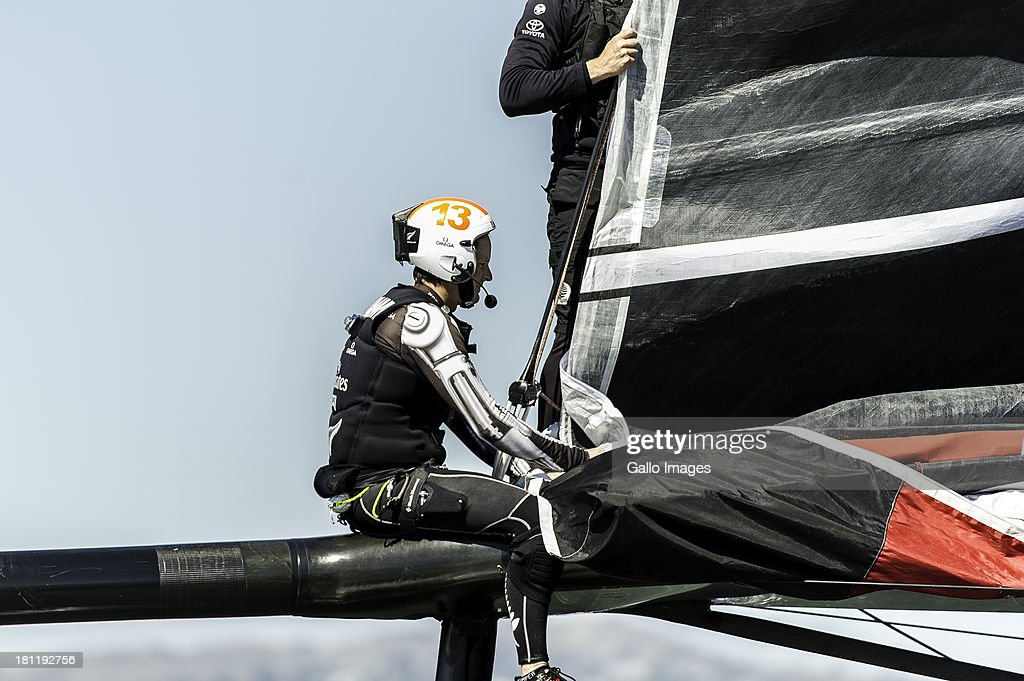 USA skippered by James Spithill (AUS) and Emirates Team New Zealand skippered Dean Barker (NZL) Sailed in AC 72s carbon catamarans during day 9 of the America's Cup on September 19th, 2013 in San Francisco. Richard Meacham sits on the bow sprit and held with the jib.
