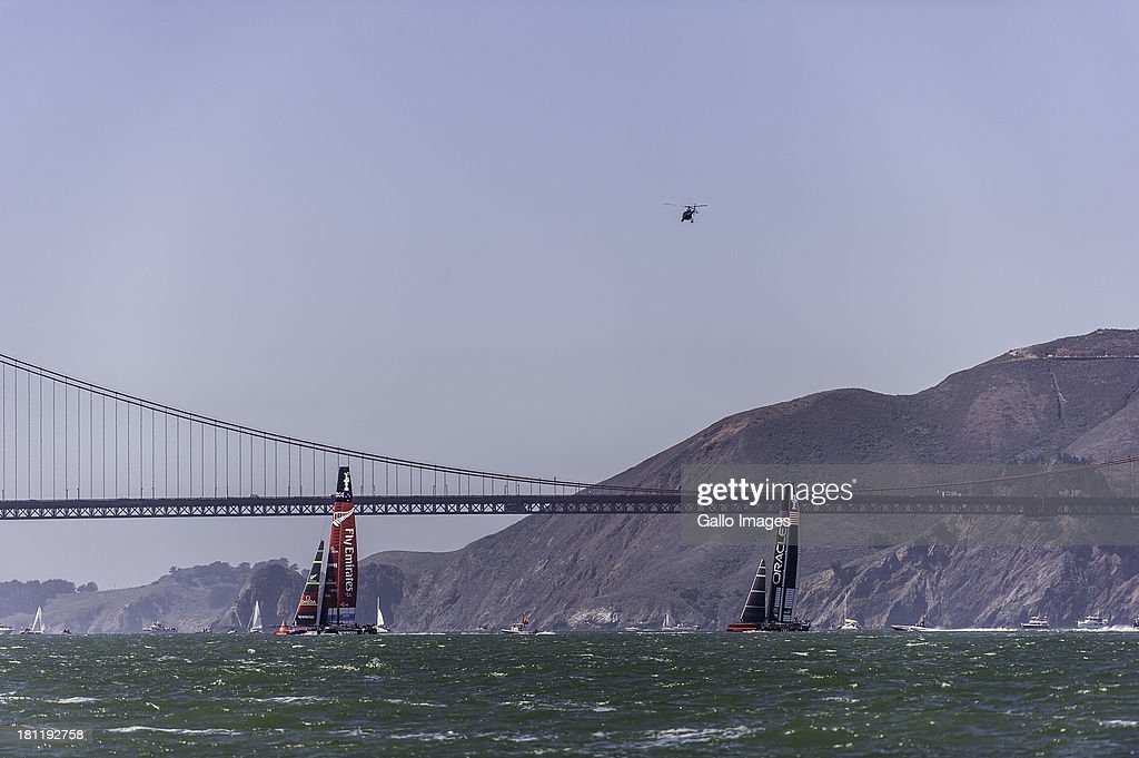 USA skippered by James Spithill (AUS) and Emirates Team New Zealand skippered Dean Barker (NZL) Sailed in AC 72s carbon catamarans during day 9 of the America's Cup on September 19th, 2013 in San Francisco. ORACLE TEAM USA cross in front of Emirates Team New Zealand in race 12.