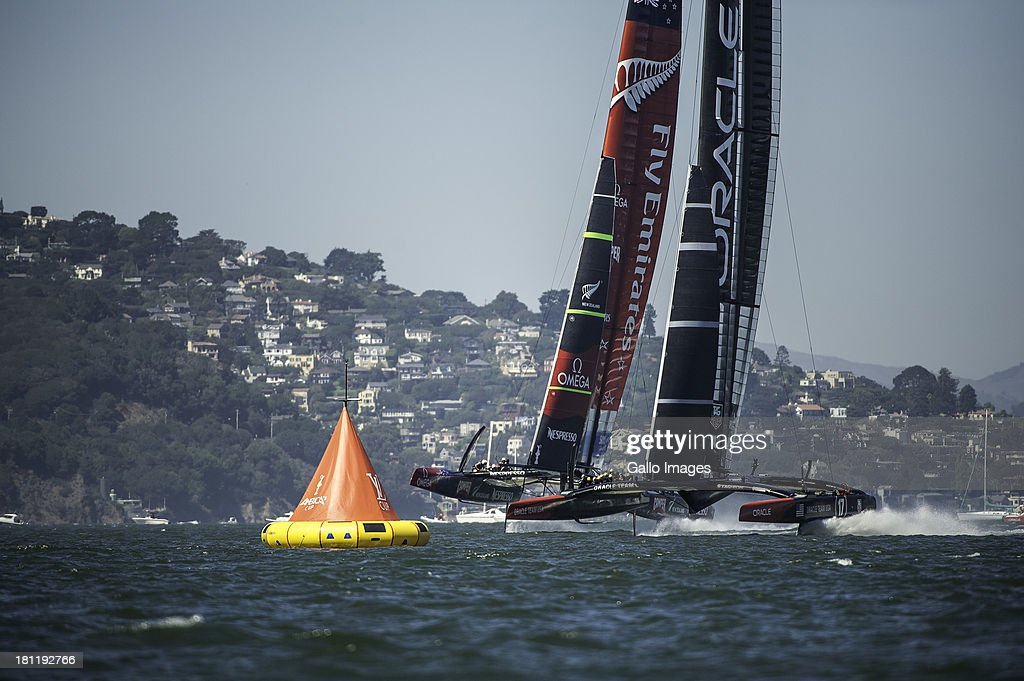 USA skippered by James Spithill (AUS) and Emirates Team New Zealand skippered Dean Barker (NZL) Sailed in AC 72s carbon catamarans during day 9 of the America's Cup on September 19th, 2013 in San Francisco. Race 12 reaching to the 1st turning mark.