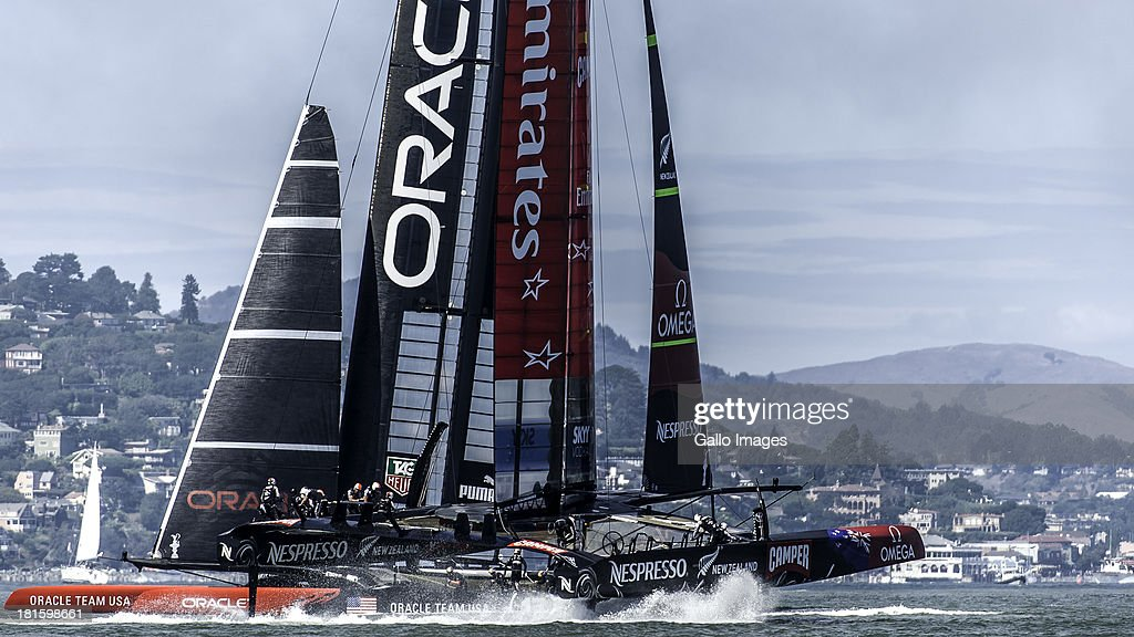 USA skippered by James Spithill (AUS) and Emirates Team New Zealand skippered Dean Barker (NZL) Sailed in AC 72s carbon catamarans during day 12 of the America's Cup on September 22, 2013 in San Francisco, California. Sailed in light fog ORACLE TEAM USA beats Emirates Team New Zealand in race 14