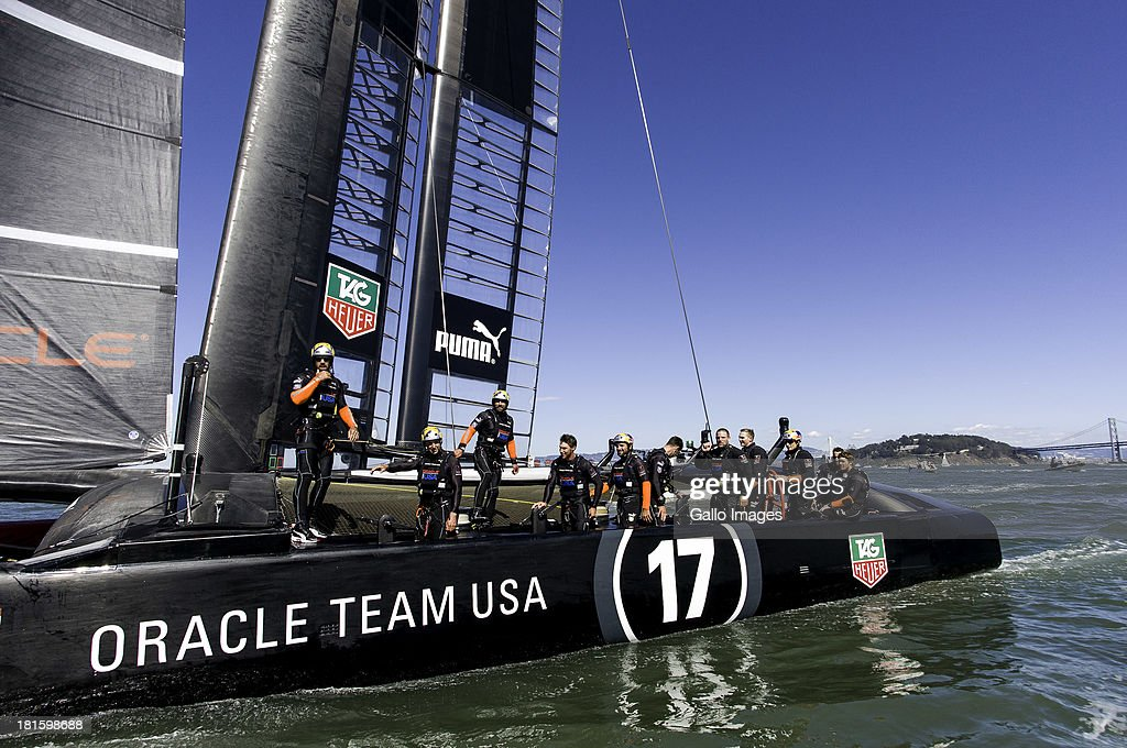 USA skippered by James Spithill (AUS) and Emirates Team New Zealand skippered Dean Barker (NZL) Sailed in AC 72s carbon catamarans during day 12 of the America's Cup on September 22, 2013 in San Francisco, California. ORACLE TEAM USA crew after winning race 14