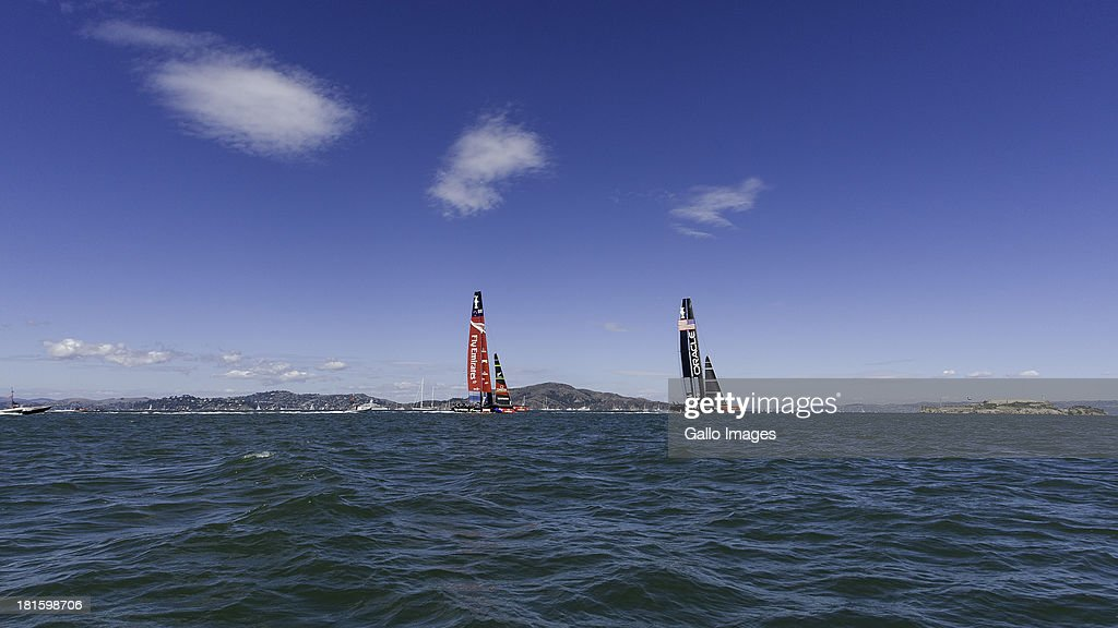 USA skippered by James Spithill (AUS) and Emirates Team New Zealand skippered Dean Barker (NZL) Sailed in AC 72s carbon catamarans during day 12 of the America's Cup on September 22, 2013 in San Francisco, California. ORACLE TEAM USA ahead of Emirates Team New Zealand in race 14