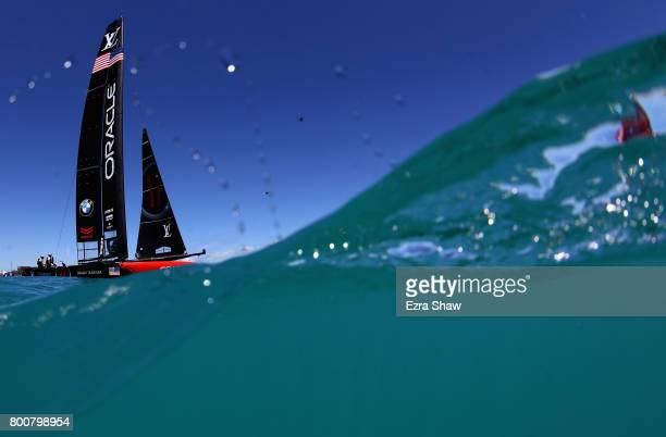 USA skippered by Jimmy Spithill in action against Emirates Team New Zealand helmed by Peter Burling on day 4 of the America's Cup Match Presented by...