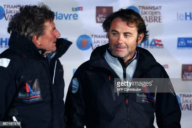 Skippers of the 'Bastide Otio' monohull Imoca Kito de Pavant and Yannick Bestaven pose in Le Havre northwestern France on October 28 during the...