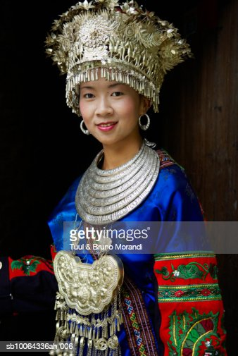 Skirt Miao woman in traditional costume, portrait