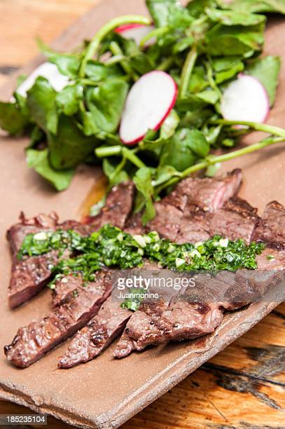 Grilled flank steak stock photos and pictures getty images