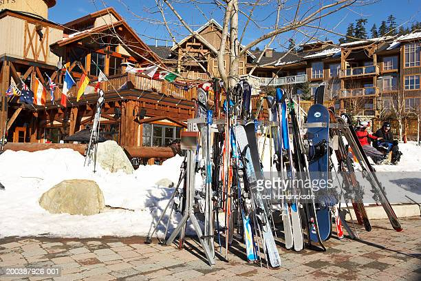 Skis and snowboards in rack