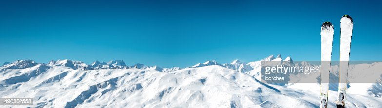 Skis In Front Of Idyllic Mountain Range