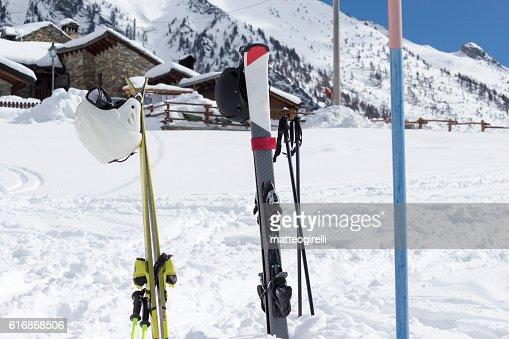skis in the snow with background blue sky : Stock Photo
