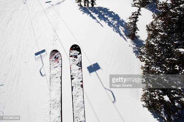 Skis of skier on ski lift