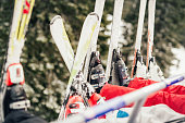 Four unrecognizable skier driving on ski lift. Close-up of a skis.
