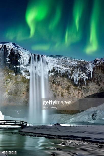 Skogafoss Waterfall and Green Aurora, Iceland