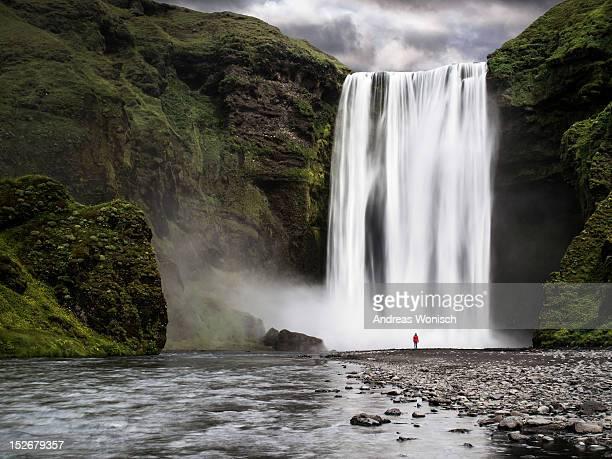 Skogafoss waterfall with woman