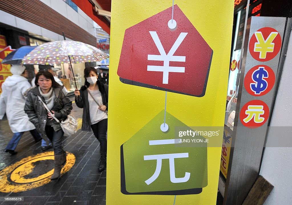 SKorea-Japan-economy-trade-forex,FOCUS by Jung Hawon This photo taken on February 1, 2013 shows Japanese tourists walking past a currency exchange sign at a shopping district in Seoul. A surging won and waning yen are eroding the bottom lines of South Korea's export powerhouses who are feeling the pinch after years of gobbling up global market share from their Japanese rivals. AFP PHOTO / JUNG YEON-JE
