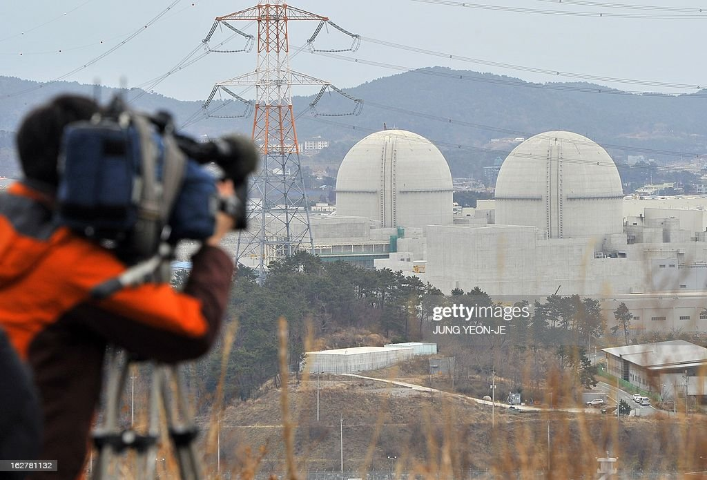 WITH 'SKorea-nuclear-energy,FOCUS' by Lim Chang-Won This photo taken on February 5, 2013 shows a camerman taking video footage of South Korea's nuclear power reactor under construction, Shin-Kori 3 and 4 called APR-1400, in Gori near the southern port of Busan. South Korea has big plans to become a major nuclear energy player, but they are unfolding at a time when the global industry is under intense scrutiny after the 2011 Fukushima disaster.