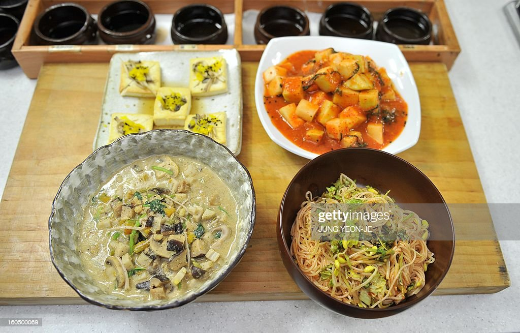 STORY SKorea-religion-Buddhism-food,FEATURE by Park Chan-Kyong This picture taken on November 2, 2012 shows temple foods of tofu sauteed in plum-sauce (L middle), mushroom casserole (L bottom), radish kimchi (R middle), noodles mixed in chilli sauce and vegetables (R bottom) and cruets (top) after a cooking class by South Korean Buddhist monk Jeokmun at his Sudoksa temple in Pyeongtaek City, about 60 kilometers (38 miles) south of Seoul. A centuries-old tradition of Buddhist cuisine, with strict bars on foods linked to lust or anger, is enjoying a revival in South Korea, one of Asia's most high-stress societies.