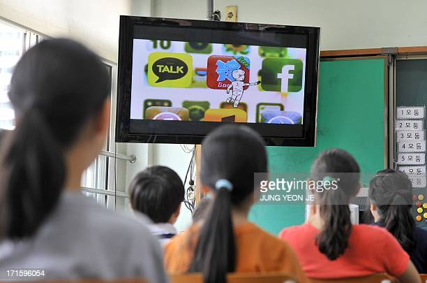 SKoreatechnologyITaddictionhealthFEATURE by JUNG HaWon This picture taken on June 11 2013 shows South Korean children looking at a TV screen during a...