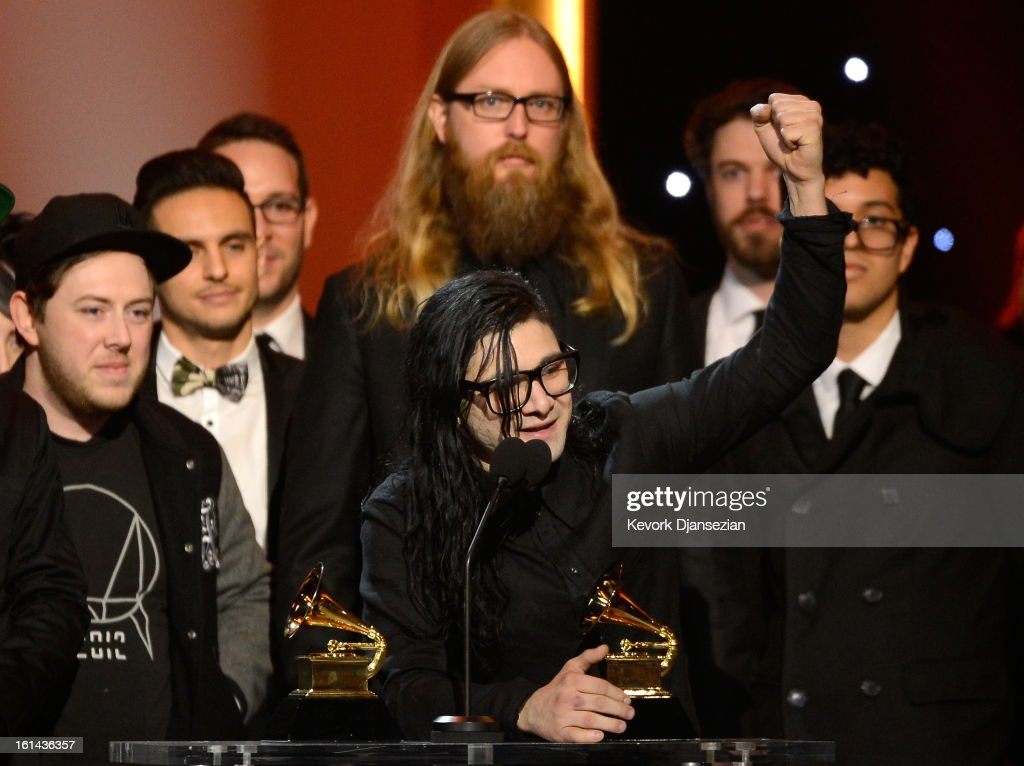 DJ <a gi-track='captionPersonalityLinkClicked' href=/galleries/search?phrase=Skrillex&family=editorial&specificpeople=7574565 ng-click='$event.stopPropagation()'>Skrillex</a> (C) accepts Best Dance/Electronica Album for 'Bangarang' onstage at the The 55th Annual GRAMMY Awards at Nokia Theatre on February 10, 2013 in Los Angeles, California.