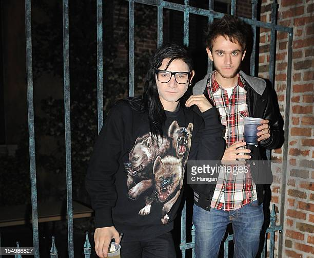 Skrillex and ZEDD pose during an after party for the OWSLA Tour Featuring Skrillex at Mardi Gras World on October 28 2012 in New Orleans Louisiana