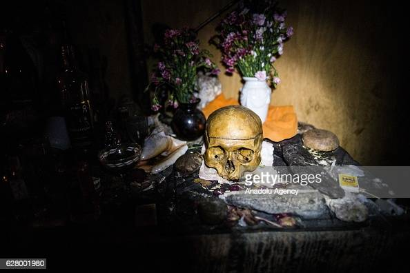 A skull is seen as people receive treatment near the Huaringas Sacred Lagoons in Huancabamba in the north of the Andes of Peru on December 6 2016...